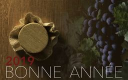 New Year Celebration with wine 2019 on grape and barrel background stock image
