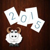 New Year celebrations with sheep and stylish text 2015. Merry Christmas, Year of the Goat and Happy New Year celebrations with sheep and stylish text 2015 over Stock Image