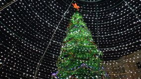 New Year celebrations in the square. NIZHNY NOVGOROD, RUSSIA - JANUARY 11, 2018: New Year celebrations in the square. Decorated and illumination. Christmas tree stock video footage