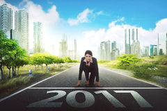 2017 New Year Challenge Concept. Asian business woman running to the city with 2017 number on the street Royalty Free Stock Images