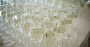New Year Champagne Flutes. Champagne. many champagne Flutes with Sparkling Champagne over new year party Background stock video footage