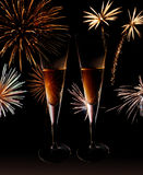 New Year champagne glasses. Champagne glasses with fireworks in the background Royalty Free Stock Images