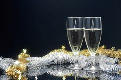 New year champagne glasses and decor. On dark background Stock Image