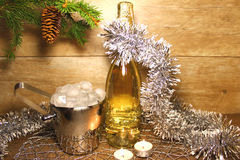 New year champagne. With tinsel and candles Royalty Free Stock Image