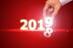 New year 2018 change to 2019 concept on red. Background stock images