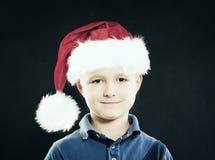 New Year Child Boy in Santa Hat Stock Image