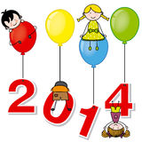 New year 2014. Children playing with the numbers and balloons Royalty Free Stock Images