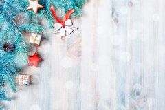 New Year and Christmas background. Christmas toys, blue fir tree branches on the wooden background. New Year and Christmas stock image