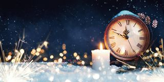 New Year, Christmas background. Christmas clock with snow. royalty free stock photos