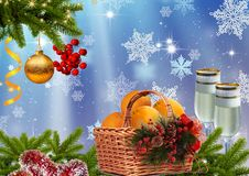 New year or Christmas background. Pine branches, fruit basket, champagne Stock Photography