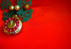 New Year and Christmas background, red with fir branches and a clock toy royalty free stock images