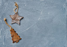 New year or Christmas background. Toy rustic wooden star and fur tree over grunge grey surface, top view Stock Photos