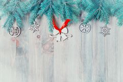 New Year and Christmas background. Christmas toys, blue fir tree on the wooden background. New Year festive still life stock photo