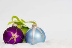 New year christmas background - violet green and blue balls Stock Photos