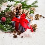 New Year and Christmas background on an white wooden background. Christmas tree branches and snow, gifts and decorations. Copy space royalty free stock images
