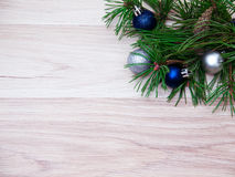 New year, Christmas ball. S, pine branches and cones on wooden background Stock Photography
