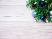 New year, Christmas ball. S, pine branches and cones on wooden background Royalty Free Stock Photo