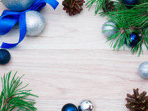 New year, Christmas ball. S, pine branches and cones on wooden background Royalty Free Stock Images