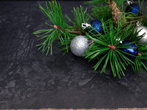 New year, Christmas balls, pine branches. New year, Christmas balls, pine  on dark background Stock Photography