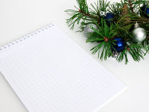 New year, Christmas balls, pine branches and a notebook. Layout Stock Photography