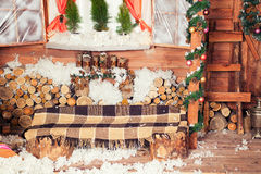 New Year and Christmas bench with plaid or wrap Royalty Free Stock Photos