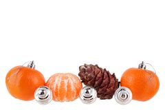 New Year and Christmas border, Christmas balls, tangerines, pine cone, ornament or pattern for greeting card, banner, calendar. On white background isolated royalty free stock photos
