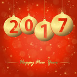 New year 2017 christmas bubbles. Red background with golden christmas bubbles and text 2017 for the new year Stock Photo