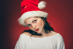 New Year Christmas cap woman portrait on red background Royalty Free Stock Photography