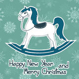 New Year and Christmas card with toy horse Royalty Free Stock Photo