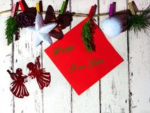 New year and Christmas card. On a white background wood lie knitted socks with Christmas ornaments and lots of Christmas Toys royalty free stock images