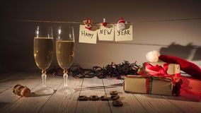 New Year and Christmas Celebration with Champagne. Two Flutes and Pouring Sparkling Wine from the Bottle. Holiday. Decorations stock footage