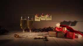 New Year and Christmas Celebration with Champagne. Two Flutes and Pouring Sparkling Wine from the Bottle. Holiday. Decorations stock video