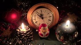 New year christmas celebration clock and candle with toys stock footage