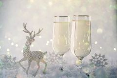 New Year and Christmas Celebration .Two Champagne Glasses and Holiday decoration. Beautiful shiny place setting for Christmas. Sparkler background, winter stock photography