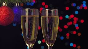 New Year and Christmas Celebration. Two Champagne. Glasses over Blinking Background stock video footage