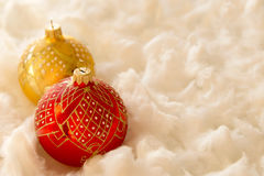 New Year and Christmas composition: fir tree balls in wadding Royalty Free Stock Images