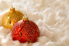 New Year and Christmas composition: fir tree balls in wadding Stock Photos