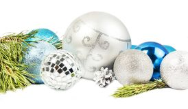 New year and Christmas composition with fir tree branch, beautiful silver ball and blue balls. On white background royalty free stock images