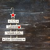 New Year or Christmas composition flat lay top view Xmas holiday celebration handmade handicraft wooden garland with text dark. Wood background copy space royalty free stock image