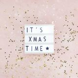 New Year or Christmas composition flat lay top view Xmas holiday celebration handmade handicraft wooden garland with text pink. Background copy space Template stock image