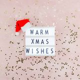 New Year or Christmas composition flat lay top view Xmas holiday celebration handmade handicraft wooden garland with text pink. Background copy space Template royalty free stock photography