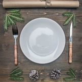 New Year or Christmas concept, cutlery on red napkin on a plate. New Year or Christmas concept, cutlery on a red napkin on a plate stock images
