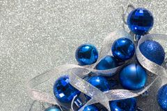 New year christmas decoration balls blue shiny glitter background of balls silver ribbon stock photos
