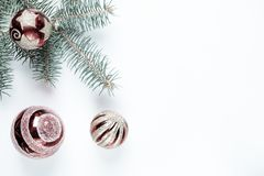 New year, Christmas decoration. Fir branches with toys balls on a background of fabric. stock photo