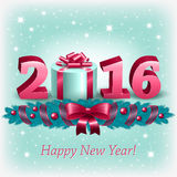 New Year 2016 and christmas decoration. New Year 2016, a gift box and christmas decoration on a light background Stock Images