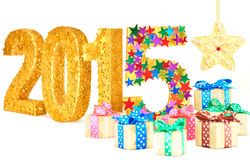 New Year 2015 decoration. Handmade colorful stars, gift boxes Royalty Free Stock Photos