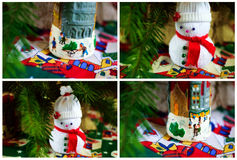 New Year and Christmas decoration. With snowman and candle on colorful  tablecloth Royalty Free Stock Photo