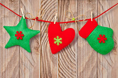 New Year 2015, Christmas decoration on wood background. New Year 2015 Christmas decoration handmade star, mitten and heart on wood background Stock Photography