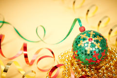 New Year 2015 decorations. Christmas handmade, colorful ball. Beads on gold background Stock Images
