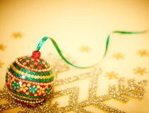 New Year 2015. Christmas decorations, ball, snowflakes. New Year 2015, Christmas decorations, handmade, colorful ball, snowflakes, ribbons on gold background Royalty Free Stock Images